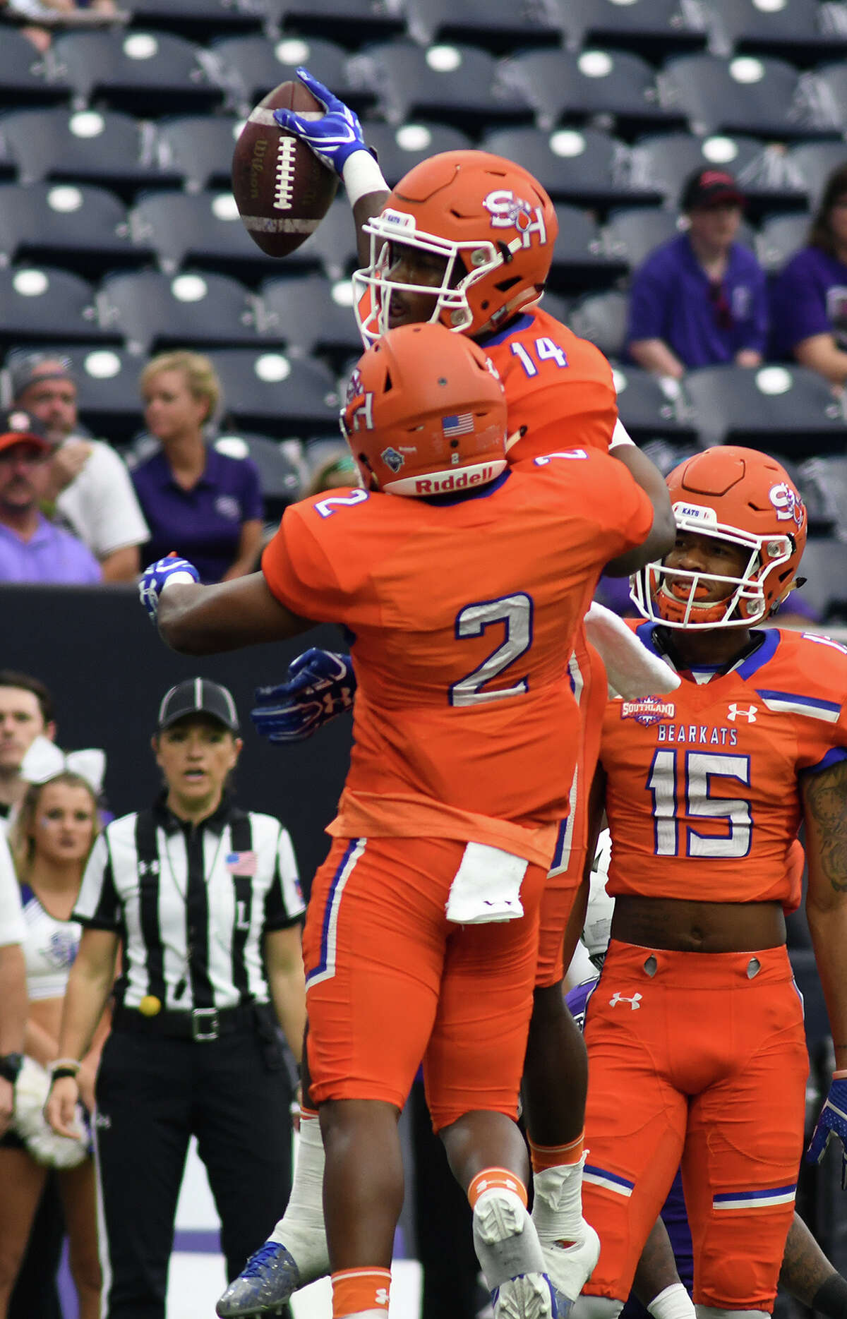Sam Houston State junior wide receiver Davion Davis (14) celebrates his first quarter touchdown against Stephen F. Austin with teammates Tyler Scott (2) and Coree Compton (15) during their Battle of the Piney Woods clash at NRG Stadium in Houston on Saturday, Oct. 7, 2017. (Photo by Jerry Baker/Freelance)