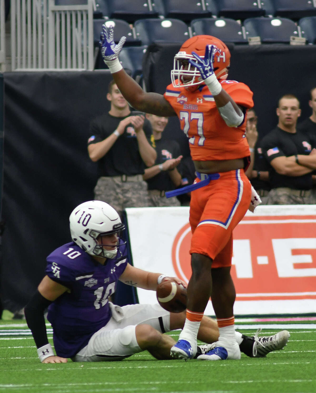 Sam Houston State junior defensive tackle Chris Stewart (97) celebrates a first quarter sack of Stephen F. Austin sophomore quarterback Jake Blumrick (10) during their Battle of the Piney Woods clash at NRG Stadium in Houston on Saturday, Oct. 7, 2017. (Photo by Jerry Baker/Freelance)