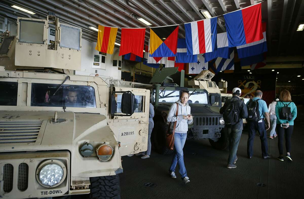 Visitors tour the hangar bay and vehicles of the US Navy amphibious assault ship USS Essex during Fleet Week in San Francisco, Calif. on Saturday Oct. 7, 2017.