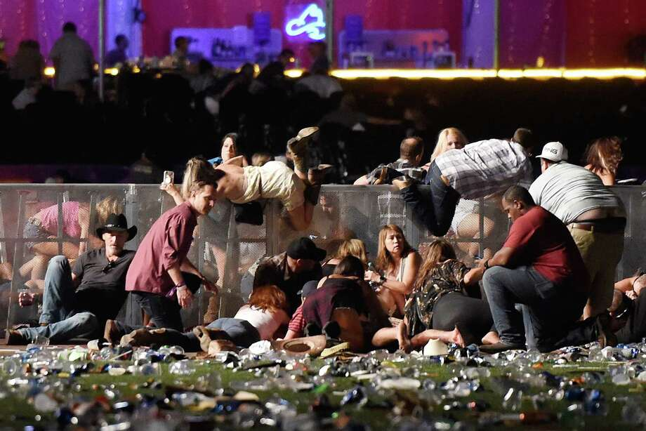 Concertgoers scramble for shelter at the Route 91 Festival in Las Vegas after a gunman opened fire on the crowd of approximately 22,000 country music fans Sunday night, killing 58 people.  Photo: David Becker, Stringer / 2017 Getty Images
