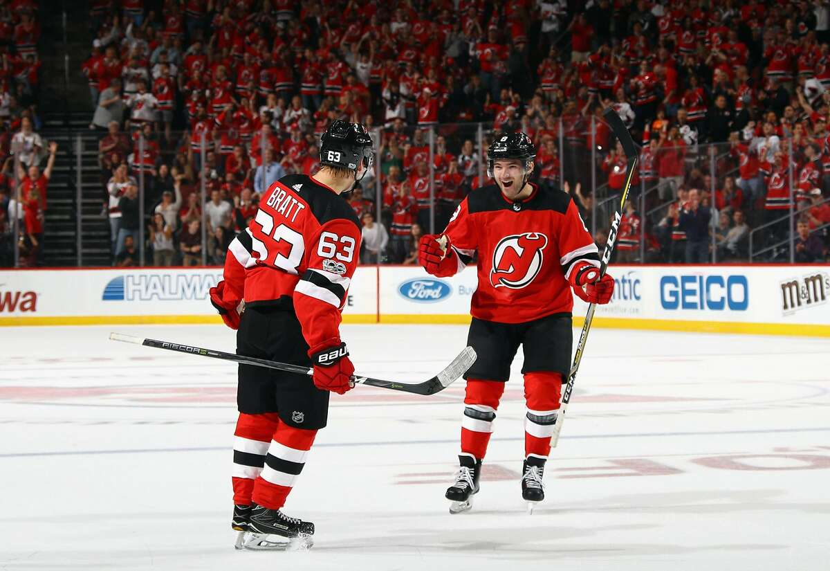 NEWARK, NJ - OCTOBER 07: With both players sking in their first NHL games, Jesper Bratt #63 (l) celebrates his first NHL goal and is joined by Will Butcher #8 (r) during the game against the Colorado Avalanche at the Prudential Center on October 7, 2017 in Newark, New Jersey. (Photo by Bruce Bennett/Getty Images)