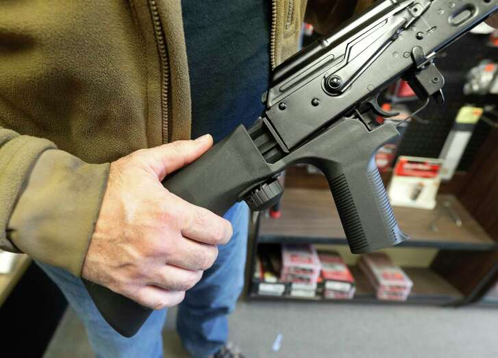 """A """"bump stock"""" device fits on a semi-automatic rifle to make it fire like a fully automatic weapon."""