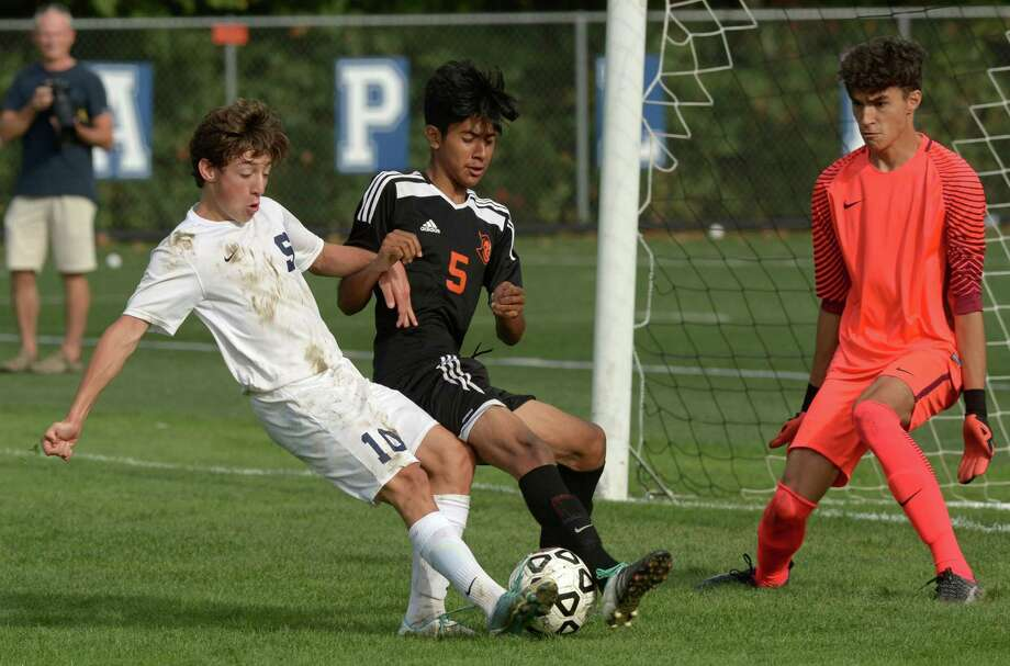 Wrecker #10 Patricio Perez Elorza goes to the goal against Black Knight #5 Giancarlo Pardo and goalkeeper Alex Graybar as the Staples High School Wreckers take on Stamford High School Black Knights in their soccer game Saturday, October 7, 2017, in Westport, Conn. Photo: Erik Trautmann / Hearst Connecticut Media / Norwalk Hour
