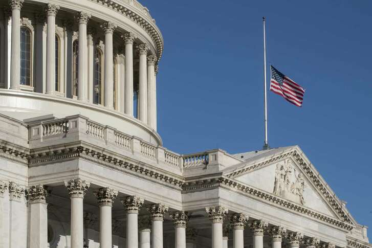 The American flag flies at half-staff over the U.S. Capitol following the deadly mass shooting in Las Vegas.  (AP Photo/J. Scott Applewhite)
