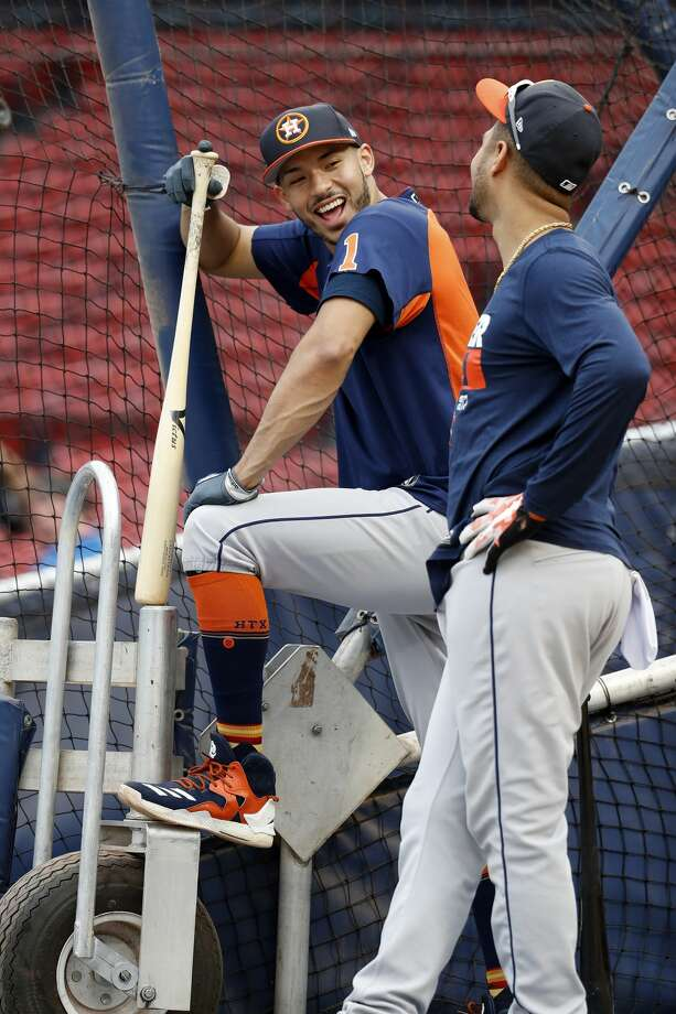 Houston Astros Carlos Correa, and Yuli Gurriel wait their turn during batting pracrice as the Astros worked out at Fenway Park, Saturday, Oct. 7, 2017, in Boston , ahead of Sunday's ALDS Game 3. ( Karen Warren / Houston Chronicle ) Photo: Karen Warren/Houston Chronicle