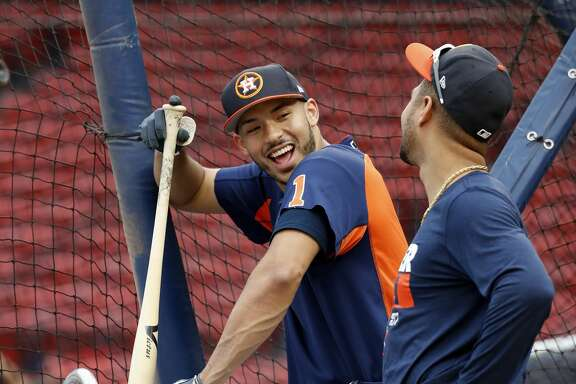 Houston Astros Carlos Correa, and Yuli Gurriel wait their turn during batting pracrice as the Astros worked out at Fenway Park, Saturday, Oct. 7, 2017, in Boston , ahead of Sunday's ALDS Game 3. ( Karen Warren / Houston Chronicle )