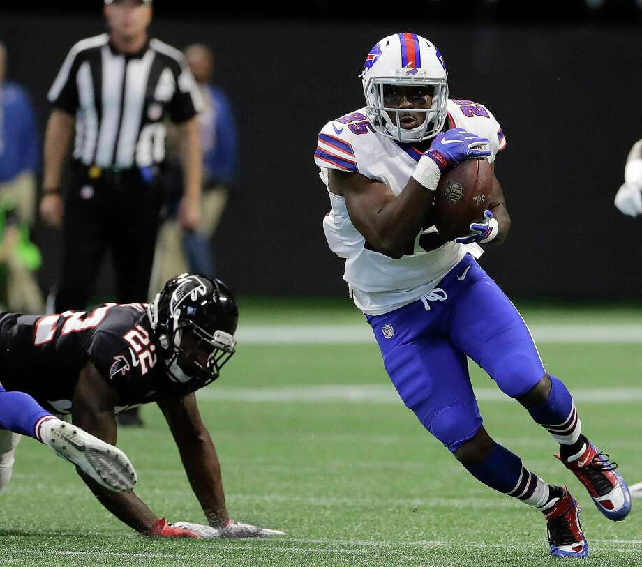 Buffalo Bills running back LeSean McCoy (25) runs by Atlanta Falcons strong safety Keanu Neal (22) during the first half of an NFL football game, Sunday, Oct. 1, 2017, in Atlanta. (AP Photo/David Goldman) ORG XMIT: GAMS106 Photo: David Goldman / Copyright 2017 The Associated Press. All rights reserved.