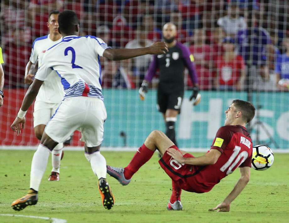 Panama's Michael Murillo, left, throws Christian Pulisic of the United States to the ground, resulting in a yellow card for Murillo during Friday night's World Cup qualifying match at Orlando, Fla.. The U.S. won 4-0 to keep its hopes alive of qualifying for the World Cup. Photo: Stephen M. Dowell, MBR / Orlando Sentinel
