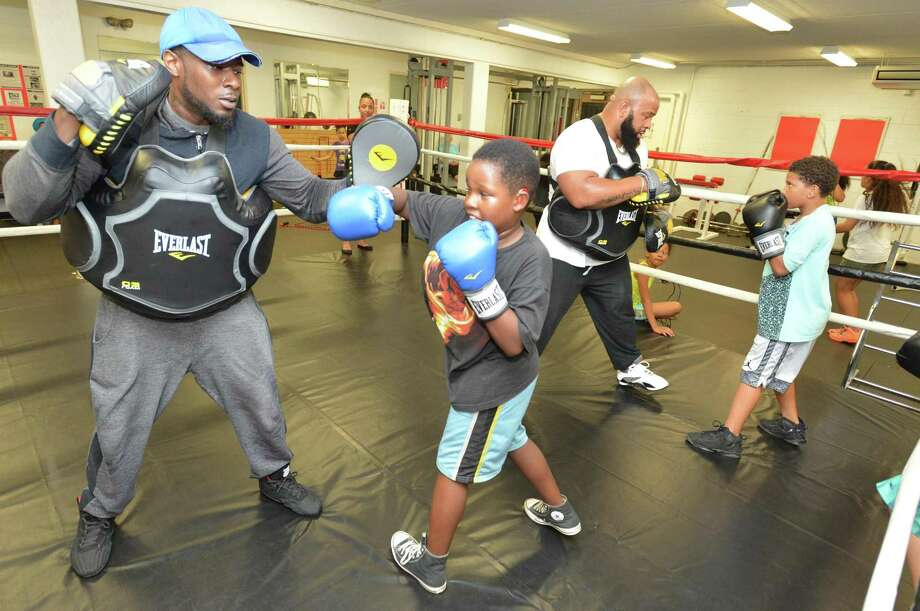 11-year old Jataveon Joyner works on some techniques in the ring with trainer Lamar Jones during Norwalk Police Activities League Boxing Program at The Norwalk Senior Center on Wednesday September 27, 2017 in Norwalk Conn. Photo: Alex Von Kleydorff / Hearst Connecticut Media / Norwalk Hour