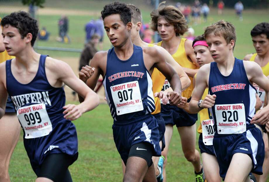 Schenectady's Maazin Ahmed, center bib #907, on his way to a second place in the boys Div. II race at the Annual Grout Invitational Saturday Oct. 7, 2017 in Schenectady, NY.  (John Carl D'Annibale / Times Union) Photo: John Carl D'Annibale / 20041788A