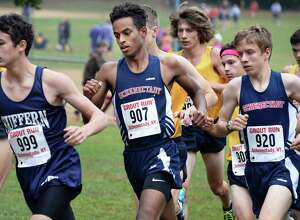 Schenectady's Maazin Ahmed, center bib #907, on his way to a second place in the boys Div. II race at the Annual Grout Invitational Saturday Oct. 7, 2017 in Schenectady, NY.  (John Carl D'Annibale / Times Union)