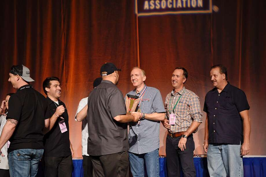 The Saint Arnold Brewing Co. crew receives its award Saturday after being named the midsize brewery of the year at the Great American Beer Festival in Denver. Photo: Photo By Miguel Rivas