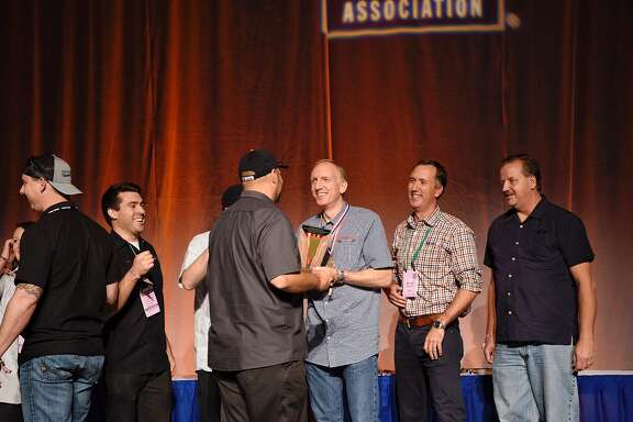 The Saint Arnold Brewing Co. crew receives its award Saturday after being named the midsize brewery of the year at the Great American Beer Festival in Denver.