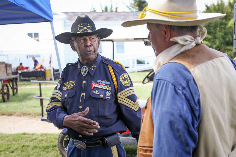 Retired Sgt. Maj. James Williams, who served with the Buffalo Soldiers, left, speaks with Conroe resident William Williams, right, during the Texian Heritage Festival on Saturday, at Fernland Historical Park in Montgomery. The Buffalo Soldiers were a segregated U.S. Army regiment that was active from 1886-1951. Photo: Michael Minasi, Staff Photographer / © 2017 Houston Chronicle