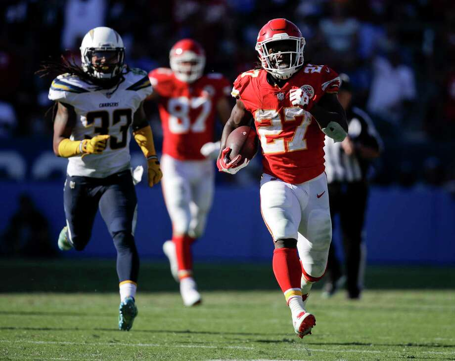 FILE - In this Sept. 24, 2017, file photo, Kansas City Chiefs running back Kareem Hunt, right, runs for a touchdown against the Los Angeles Chargers during the second half of an NFL football game in Carson, Calif. Hunt was the AFC offensive player of the month after he led the league with 401 yards rushing, caught nine passes for 137 yards and reached the end zone five times. The Chiefs face the Washington Redskins this week. (AP Photo/Jae C. Hong, File) Photo: Jae C. Hong, STF / Copyright 2017 The Associated Press. All rights reserved.