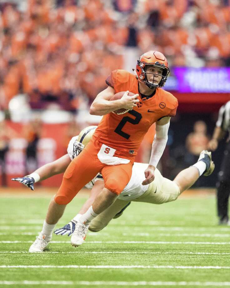 SYRACUSE, NY - OCTOBER 07:  Quarterback Eric Dungey #2 of the Syracuse Orange avoids a tackle by defensive lineman Shane Roy #93 of the Pittsburgh Panthers during the fourth quarter at the Carrier Dome on October 7, 2017 in Syracuse, New York. Syracuse defeats Pittsburgh 27-24.  (Photo by Brett Carlsen/Getty Images) ORG XMIT: 775042465 Photo: Brett Carlsen / 2017 Getty Images