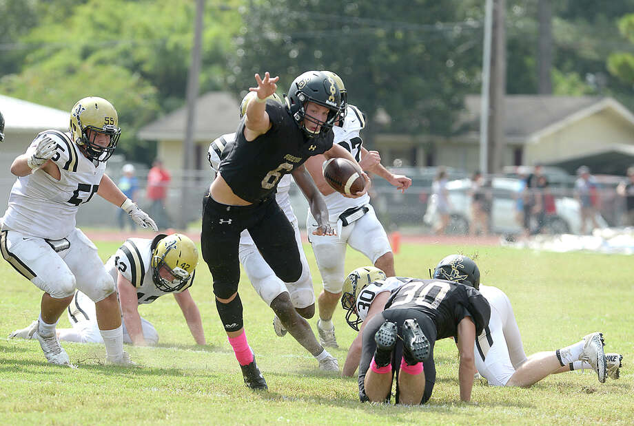 Vidor's William Fawcett leaps over the tackle attempt by Nederland's defense during their match-up Saturday at Vidor High School. Photo taken Saturday, October 7, 2017 Kim Brent/The Enterprise Photo: Kim Brent / BEN