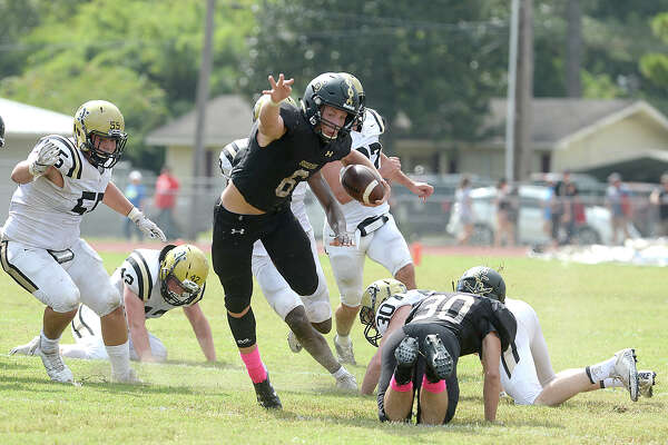 Vidor's William Fawcett leaps over the tackle attempt by Nederland's defense during their match-up Saturday at Vidor High School. Photo taken Saturday, October 7, 2017 Kim Brent/The Enterprise