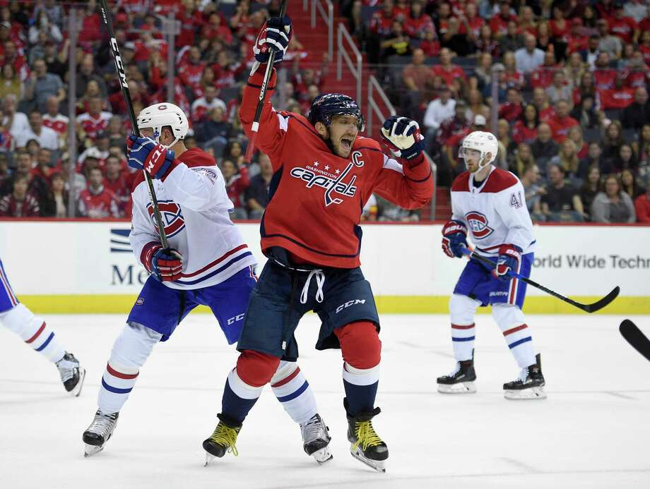 Washington's Alex Ovechkin, right, celebrates the first of his four goals after scoring in the first period of Saturday night's game against visiting Montreal. Ovechkin also had a hat trick in the Capitals' season-opening victory at Ottawa on Thursday. Photo: Nick Wass, FRE / FR67404 AP