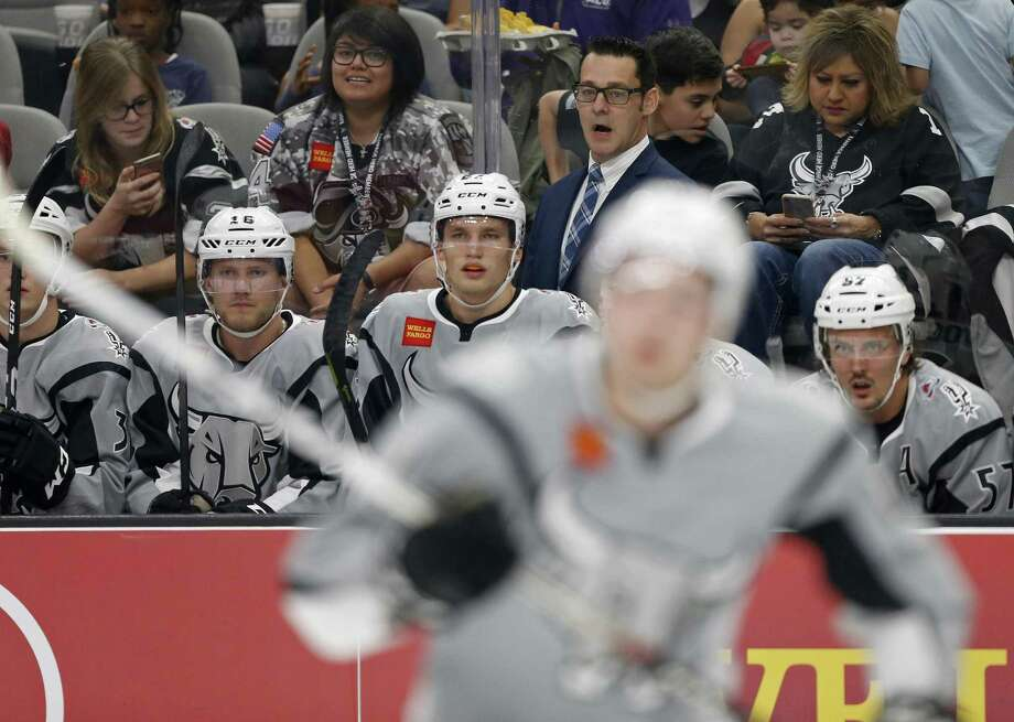 San Antonio Rampage's head coach Eric Veilleux (center rear) and players watch first period action against the Ontario Reign from the bench Saturday Oct. 7, 2017 at the AT&T Center. Photo: Edward A. Ornelas, Staff / San Antonio Express-News / © 2017 San Antonio Express-News