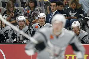 San Antonio Rampage's head coach Eric Veilleux (center rear) and players watch first period action against the Ontario Reign from the bench Saturday Oct. 7, 2017 at the AT&T Center.