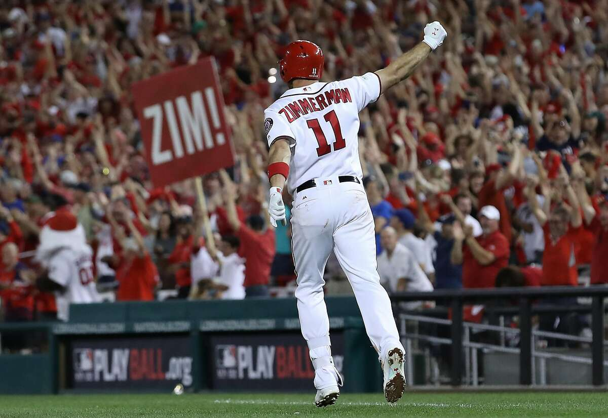 WASHINGTON, DC - OCTOBER 07: Ryan Zimmerman #11 of the Washington Nationals celebrates after hitting a game winning 3 run home run against the Chicago Cubs in the eighth inning during game two of the National League Division Series at Nationals Park on October 7, 2017 in Washington, DC. The Nationals won the game 6-3. (Photo by Win McNamee/Getty Images)
