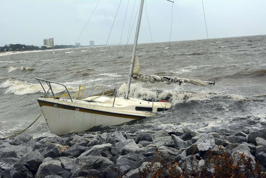 An abandoned boat takes on water on the Mississippi Gulf Coast, Saturday, Oct. 7, 2017, near Biloxi, Miss., as the outer bands of Hurricane Nate begin to batter the shore. (Justin Vicory/The Clarion-Ledger via AP) Photo: Justin Vicory, Associated Press