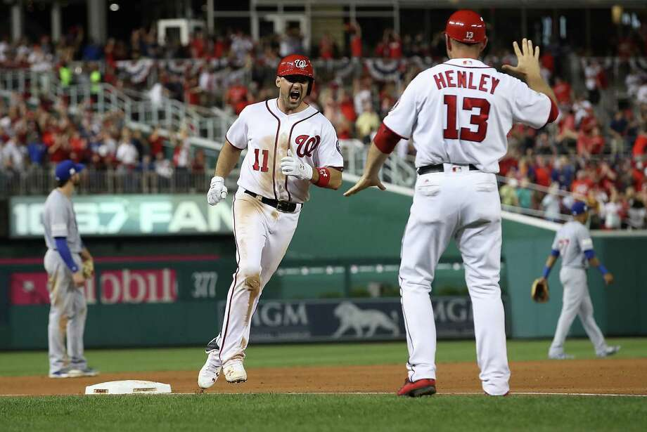 WASHINGTON, DC - OCTOBER 07:  Ryan Zimmerman #11 of the Washington Nationals celebrates after hitting a game winning 3 run home run against the Chicago Cubs in the eighth inning during game two of the National League Division Series at Nationals Park on October 7, 2017 in Washington, DC. The Nationals won the game 6-3.  (Photo by Win McNamee/Getty Images) ORG XMIT: 775053737 Photo: Win McNamee / 2017 Getty Images