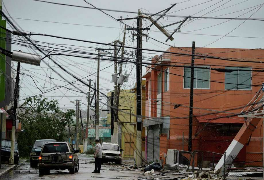 "FILE - In this Wednesday, Sept. 20, 2017 file photo, power lines are down after the impact of Hurricane Maria, which hit the eastern region of the island in Humacao, Puerto Rico. In the wake of Hurricane Maria, Facebook pledged to send a ""connectivity team"" to help restore communications in ravaged Puerto Rico. It's just one of several tech companies - among them Tesla, Google, Cisco, Microsoft and a range of startups - with their own disaster response proposals, most aimed at getting phone and internet service up and running. (AP Photo/Carlos Giusti, File) ORG XMIT: CAET630 Photo: Carlos Giusti / Copyright 2017 The Associated Press. All rights reserved."