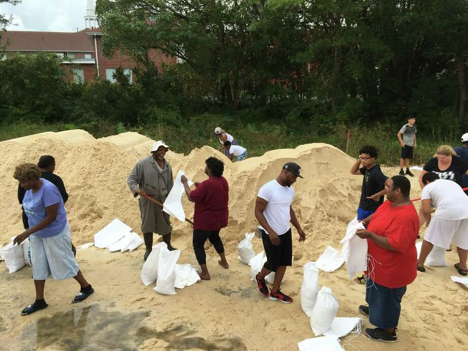 People fill sandbags to prepare for Hurricane Nate in Moss Point, Miss., on Saturday, Oct. 7, 2017. Storm surge threatens many low-lying neighborhoods in city, which was heavily flooded during 2005's Hurricane Katrina. (AP Photo/Jeff Amy) ORG XMIT: MSJA101 Photo: Jeff Amy / AP