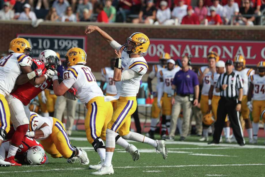 UAlbany quarterback Will Brunson throws a pass during the Danes' 41-38 double overtime loss to No. 14 Richmond on Saturday, Oct. 7, 2017 at Robins Stadium. Brunson was 18-for-29 for 339 yards and four touchdowns. (Jordan Burgess / Special to the Times Union)