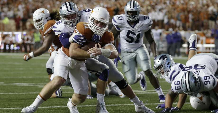 AUSTIN, TX - OCTOBER 07:  Jayd Kirby #46 of the Kansas State Wildcats tackles Sam Ehlinger #11 of the Texas Longhorns short of the goal line in the second quarter at Darrell K Royal-Texas Memorial Stadium on October 7, 2017 in Austin, Texas.  (Photo by Tim Warner/Getty Images) Photo: Tim Warner/Getty Images
