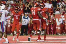 Houston wide receiver Ellis Jefferson (21) and offensive lineman Josh Jones (74) celebrate after Jefferson's touchdown during the second quarter of an NCAA college football game at TDECU Stadium on Saturday, Oct. 7, 2017, in Houston, Texas. (Joe Buvid / For the Houston Chronicle)