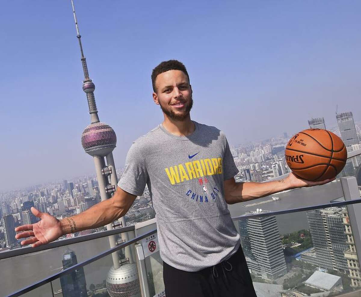 Clockwise, from top left: Klay Thompson boards a plane for China last Sunday; Kevin Durant addresses media at practice; Stephen Curry poses in Shanghai; and Nick Young plays in an