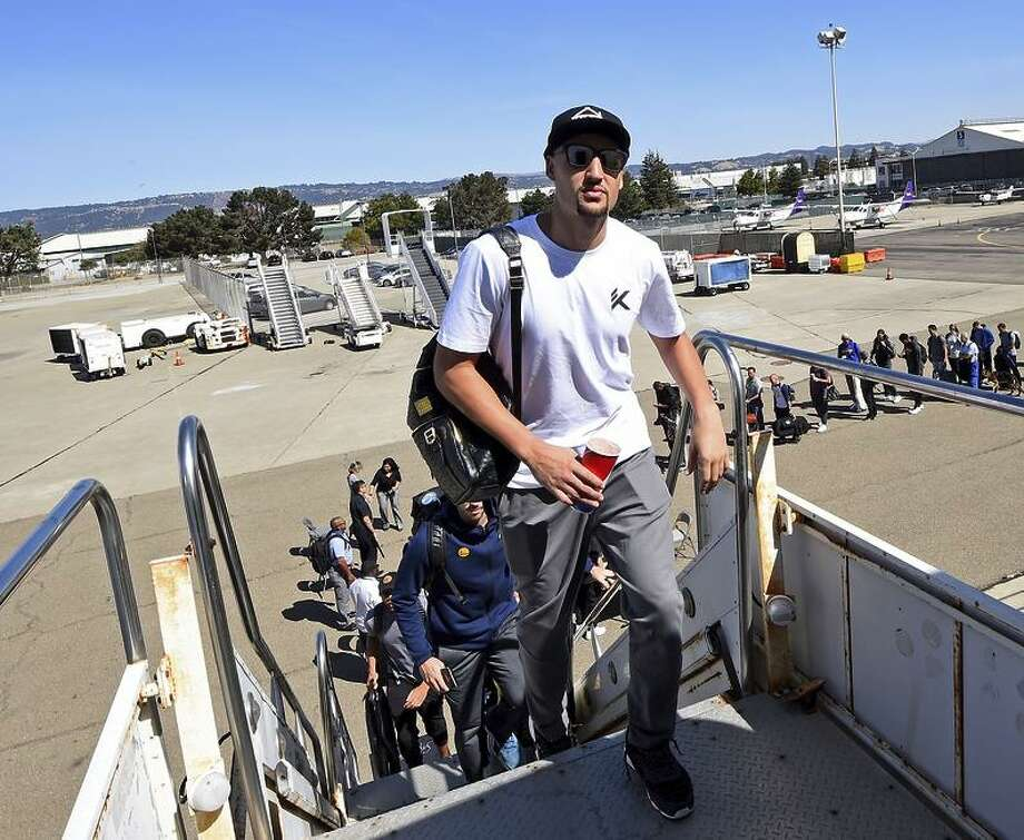 Klay Thompson of the Golden State Warriors boards the plane for 2017 NBA Global Games China on October 1, 2017 at Signature Flight Support in Oakland, California. Photo: Noah Graham / Noah Graham / NBAE / Getty Images / 2017 NBAE