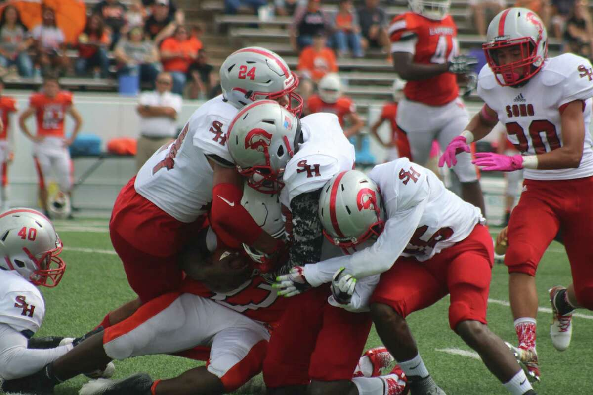 South Houston's defense swallows up a La Porte ballcarrier during first-half action Saturday. The Trojans defense kept the Bulldogs off the scoreboard until the fourth quarter.