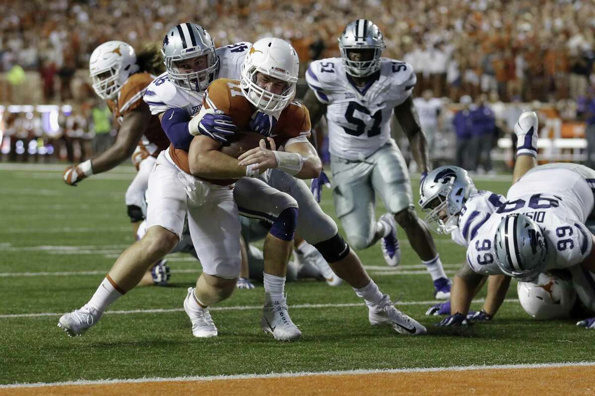 Jayd Kirby #46 of the Kansas State Wildcats tackles Sam Ehlinger #11 of the Texas Longhorns short of the goal line in the second quarter at Darrell K Royal-Texas Memorial Stadium on October 7, 2017 in Austin, Texas.