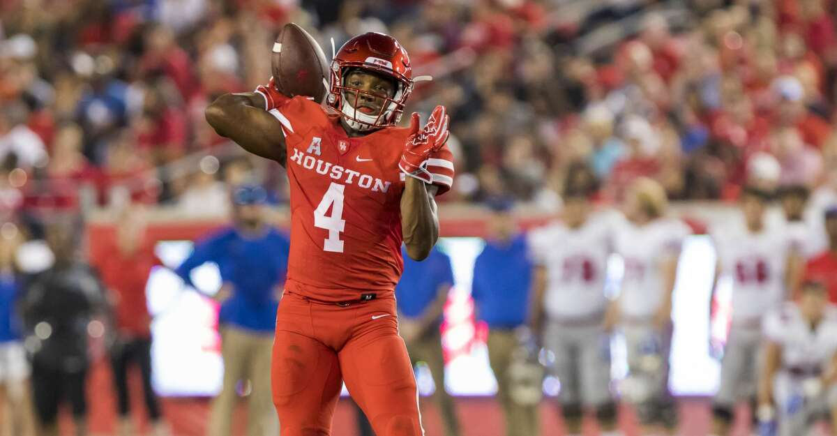Houston wide receiver DÃ?•Eriq King (4) throws a pass to quarterback Kyle Postma for a touchdown in the second quarter of an NCAA college football game at TDECU Stadium on Saturday, Oct. 7, 2017, in Houston, Texas. (Joe Buvid / For the Houston Chronicle)
