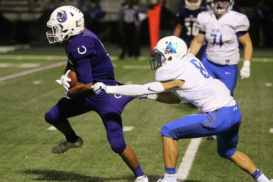 Senior cornerback Mason Dooley grabs ahold of the pants of the Broncos Martin Gallegos to try and stop him for a gain in the game against Dayton last Friday night. Photo: David Taylor