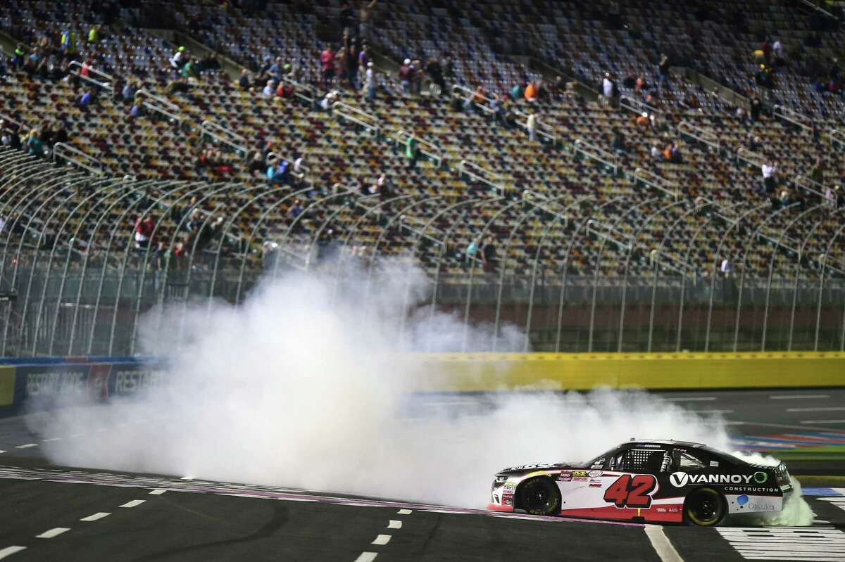 CHARLOTTE, NC - OCTOBER 07: Alex Bowman, driver of the #42 HendrickCars.com Chevrolet, celebrates with a burnout after winning the NASCAR XFINITY Series Drive for the Cure 300 presented by Blue Cross Blue Shield of North Carolina at Charlotte Motor Speedway on October 7, 2017 in Charlotte, North Carolina. (Photo by Jared C. Tilton/Getty Images) ORG XMIT: 775053113