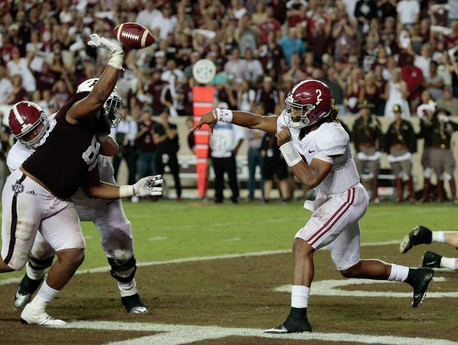 Jalen Hurts #2 of the Alabama Crimson Tide has his pass attempt knocked down by Kingsley Keke #88 of the Texas A&M Aggies in the fourth quarter at Kyle Field on October 7, 2017 in College Station, Texas. Photo: Bob Levey /Getty Images / 2017 Getty Images