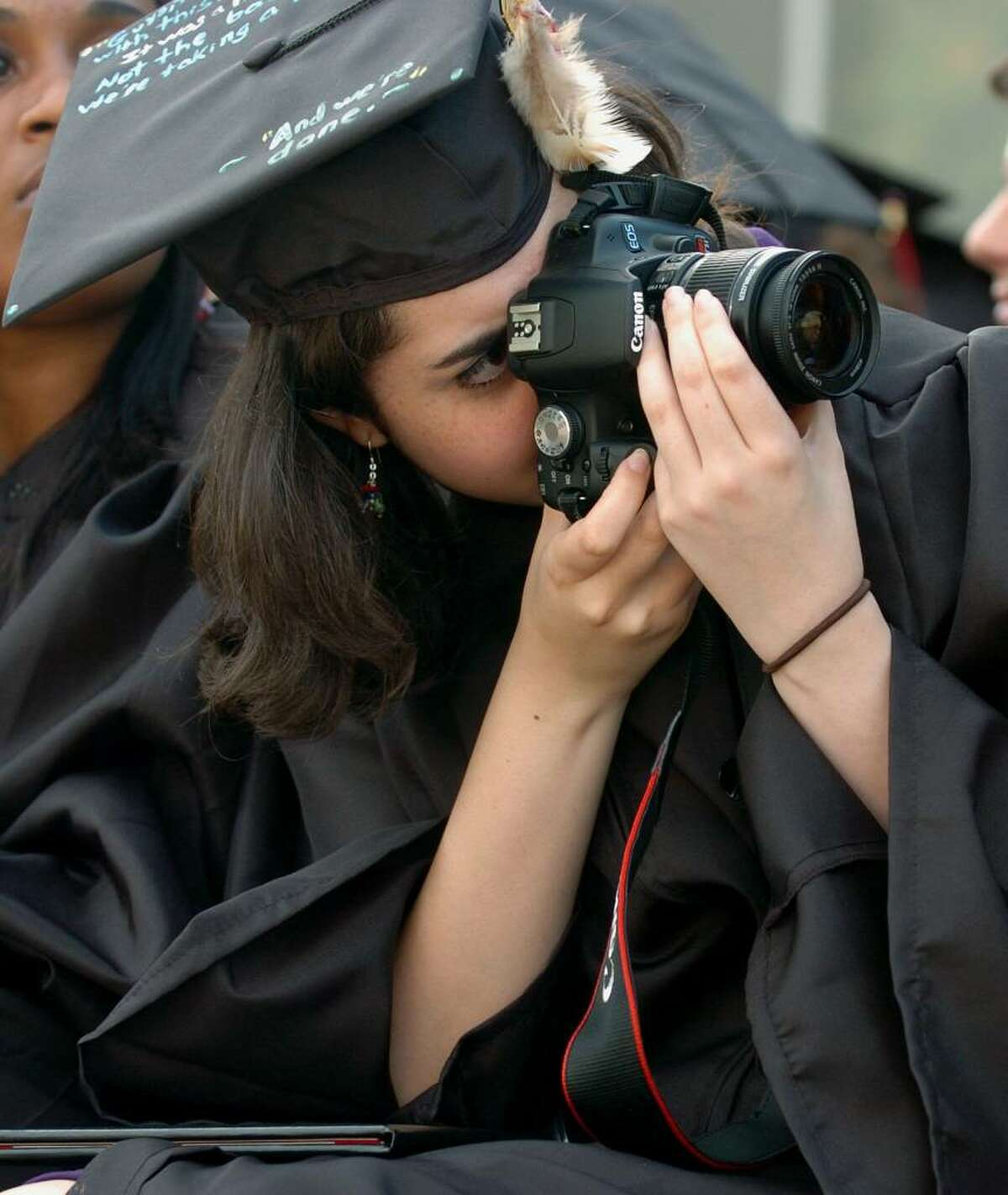 Graduate Katherine Roman takes pictures of her friends as they graduate, during Fairfield Warde's 6th Annual Commencement Exercises in Fairfield, Conn. on Thursday June 24, 2010.