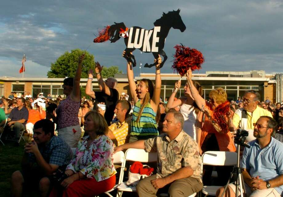 Lauren Allen, 17, holding Mustang sign, and the rest of the Allen family jump up to cheer for graduate Luke Allen, during Fairfield Warde's 6th Annual Commencement Exercises in Fairfield, Conn. on Thursday June 24, 2010. Photo: Christian Abraham / Connecticut Post