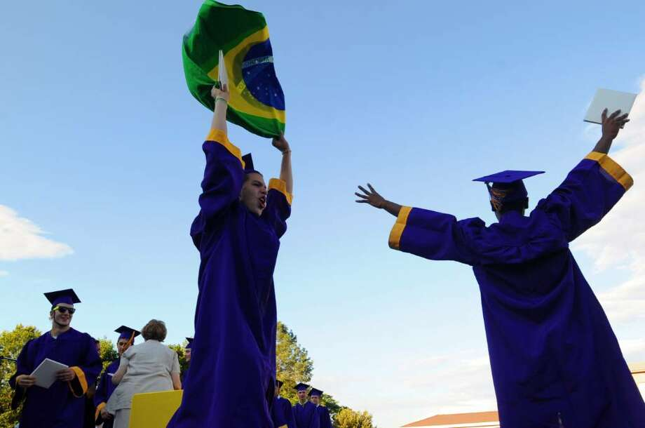 Diego Larrosa and Vincent Hope celebrate their graduation while demonstrating support for the Brazilian soccer team during Westhill High School Class of 2010 Commencement Thursday, June 24, 2010. Photo: Keelin Daly / Stamford Advocate