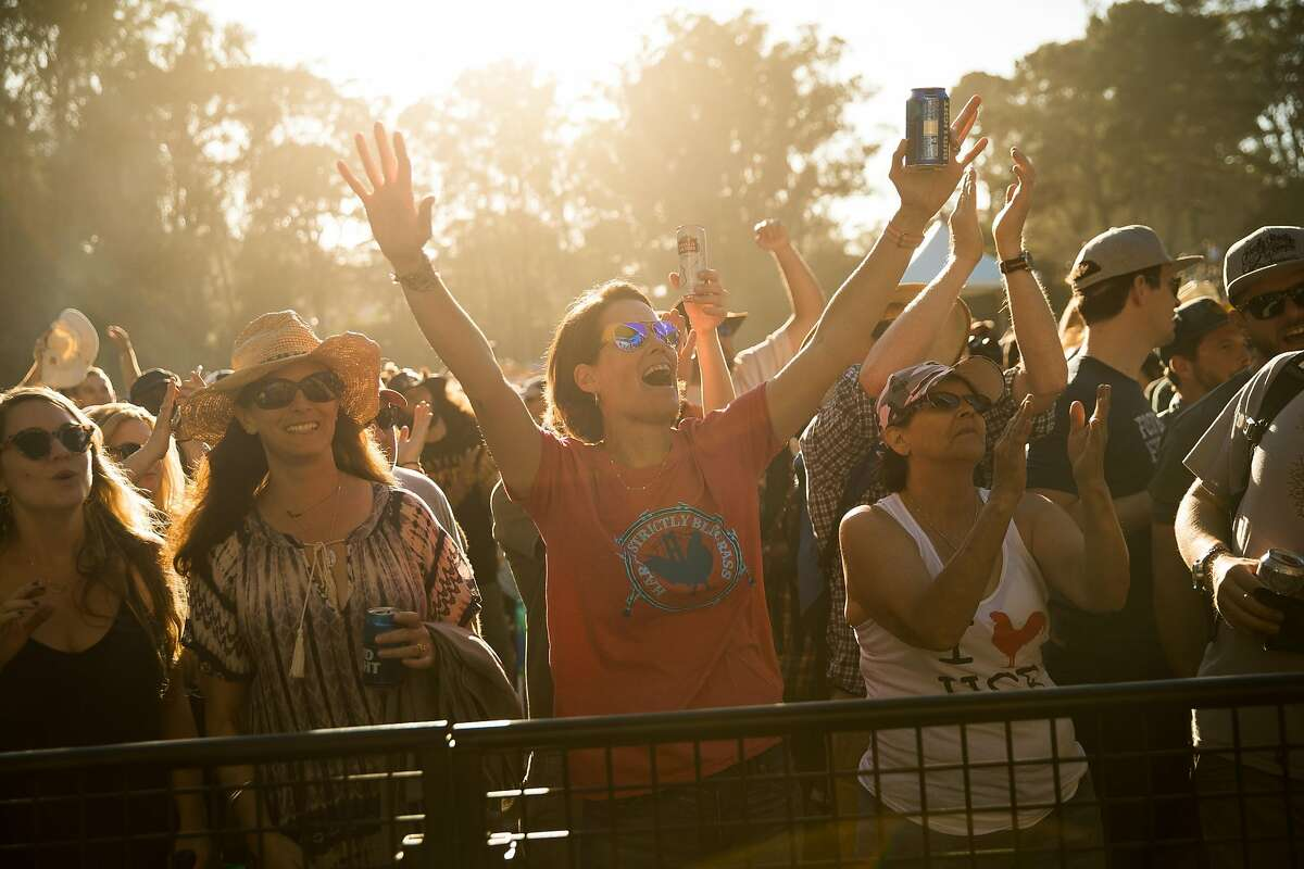 Jane Anne Randolph cheers on Robert Earl Keen at the Tower of Gold Stage at the Hardly Strictly Bluegrass in San Francisco, Calif. Saturday, October 7, 2017.