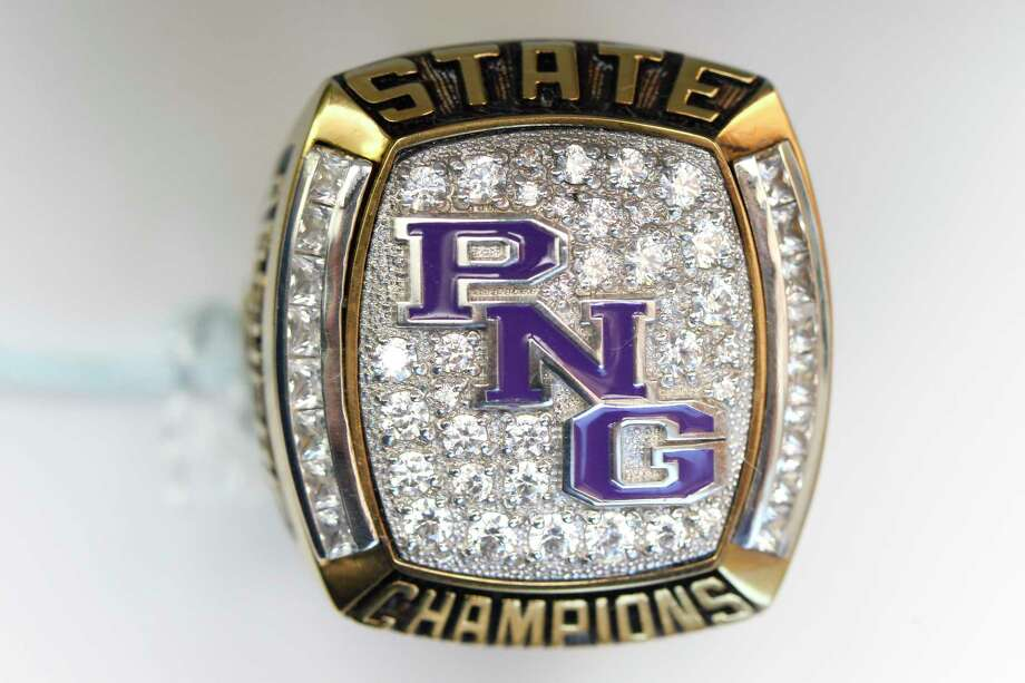 The Port Neches-Groves 2017 baseball state championship rings feature the school's initials on the face with their season record and the player or coach's last name on the sides. Photo taken Wednesday 10/4/17 Ryan Pelham/The Enterprise Photo: Ryan Pelham / ©2017 The Beaumont Enterprise/Ryan Pelham