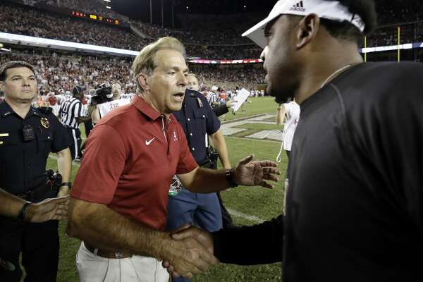 Alabama coach Nick Saban, left, shakes hands with Texas A&M coach Kevin Sumlin after an NCAA college football game Saturday, Oct. 7, 2017, in College Station, Texas. Alabama won 27-19. (AP Photo/David J. Phillip)