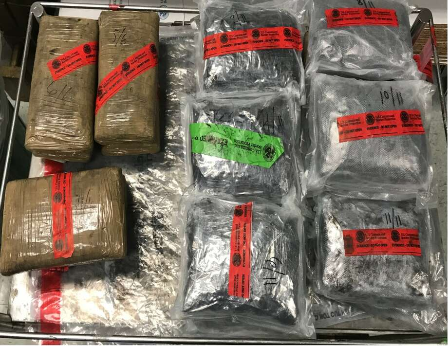 Six packages containing 14.55 pounds of alleged heroin and 11 packages containing 26.01 pounds of alleged crystal methamphetamine were discovered in a 2007 Honda Odyssey. Photo: Courtesy