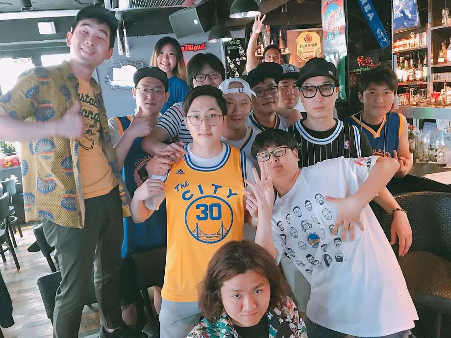 Lee Hyun Min (center, wearing yellow The City jersey) and members of the Let's Go Warriors Fan Club of South Korea celebrate their favorite NBA team, the Golden State Warriors, in a photo dated July 15, 2017. Photo: Photo Courtesy Lee Hyun Min