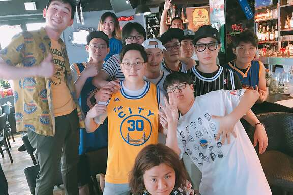 Lee Hyun Min (center, wearing yellow The City jersey) and members of the Let's Go Warriors Fan Club of South Korea celebrate their favorite NBA team, the Golden State Warriors, in a photo dated July 15, 2017.